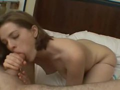 Pretty beauty sucks and fondles in hotel bedroom