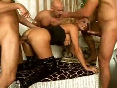 Gangbang blonde in latex boots fuck and facial