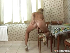 Blond legal age teenager in the kitchen