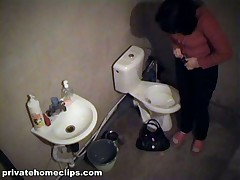 Salacious brunette gadget used her time in the shitter to look in the pocket-glass. This babe pissed while checking her make-up and then put on her beige panty and jeans and got out of the room having no idea this babe was filmed!