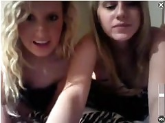A couple of cute college coeds doing some web camera from a hotel room.  They hide behind a blanket for awhile, but start showing their gorgeous tits.  Then they stand up and lower their bikini bottoms to flash their pussies.