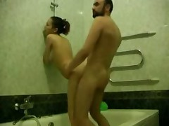 Bearded dude washes his sexy girlfriend in bathroom, soaping her pleasing hole and then strips to fuck her right there.
