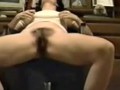 This is a great movie of a woman finger fucking herself at the office. The camera is sitting on the ground looking up at the girl sitting in a chair. U can hear her groaning when that babe makes herself cum.