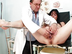 Mature brunette hair babes with nice body and nasty breasts is sitting the gynecologist table totally undressed with her legs spread so that her doctor can exam the moist crack between them. He recommends her a dildo therapy so the treatment starts as that guy introduces that sex toy unfathomable in her bald vagina. This babe becomes slutty and does treats her pussy with her own hands.