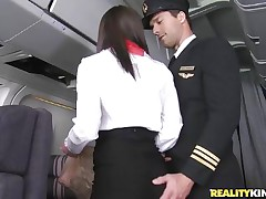 Willing for take-off captain! But previous to that, this curvy flight stewardess went down on her knees to give the pilot a blowjob! Joining the mile-high club has not at any time been this hot, especially when a beautiful brunette cabin crew undresses for the captain to fondle her large ass! Bon voyage passengers!