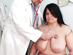 Chubby brunette hair Rosana went to doctor's to acquire her body checked up well. But there is this nasty pervert doctor who makes her naked and begins playing with her firm bulky body! See how he is toying with her huge marangos and gaping her pussy. That guy even fingers it to make her horny so that he can screw her well!