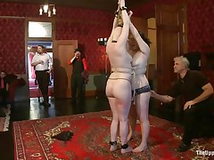 On the Upper Floor, girls all over the place are being punished. There's two tied up face to face getting caned, one more being flogged while holding a stripper pole, one more getting spanked by a man and her face slapped by a woman, one more getting her booty lashed with a whip, and one engulfing cock.