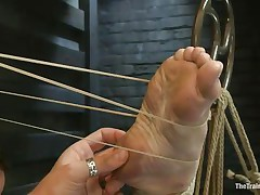 Melody Jordan is all tied up at the moment. She's getting screwed with one leg in the air and enjoying it likewise much, till a rubber band snap on the foot brings her back to earth. The position switches and now she's bent over with one leg in the air. The fellow fingers and fucks her. This babe says thank you sir.