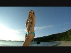 Ideal bikini beauty on a beach gets sexy