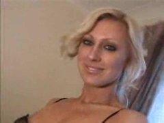 Blonde in a short dress striptease
