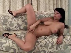 Curvy cutie masturbates on the comfy daybed