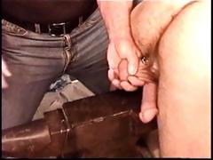 Hot muscle man Derek Da Silva gets balls bashed on iron anvil.