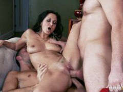 Ava Addams gets her face plastered with warm cum
