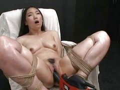 Hot Oriental girl bound and fucked with fucking machine