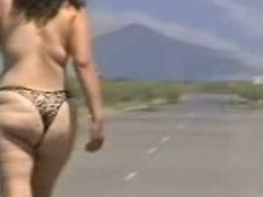 Out in the open desert walking in the centre of a highway with only a g-string covering her large wazoo body. In this public sex video u can see this aged bitch walk bare out in the open and flaunt her large fucking ass.