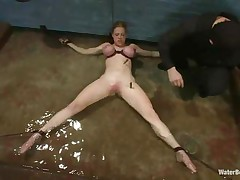 Blonde Darling is tied on the floor with her big boobs squeezed and her hot body tortured with laundry pliers. She begins to panic coz the water level is rising and pretty pretty soon breathing will be a big problem for her pretty mouth. What will that babe do if her femdom-goddess decides that she's not good to breath.