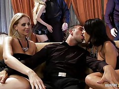 A blonde and a black brown are rubbing a guy's crotch whilst sitting on a couch. They pull out his 10-Pounder and start to engulf it, every awaiting her turn. Another pecker enters the scene and the black brown goes to blow it.