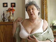 Granny takes off her shirt and bra and her heart rate increases as this babe begins massaging these big saggy boobs. Just like in her youth this fucking wench takes off her clothes to pleasure men! Granny removes these white panties and reveals her saggy shaggy cunt that she's enjoys rubbing. What she's up to next?