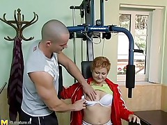 Watch this hot red headed cougar who takes advantage of this youthful gym instructor. That babe has great sex experience and starts seducing him, like this babe well knows. This old honey has all this babe needs to make a man happy. That babe starts taking off her clothing to turn the youthful stud on. That guy loves playing with her tits.