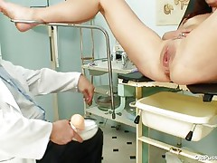 Her pussy is still taut and fine for a hard cock to come into it but first, the gynecologist needs to check it closely and after gaping it this guy inserts a plastic speculum unfathomable in it revealing what is inside. Her vagina looks fine on the inside but all that fucking left some mess in there so now is time for a deep, warm, milk enema.