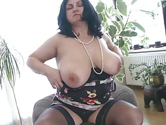 This chunky mature is going insane and definitely in need of some masturbation. So with out wasting any time this babe is revealing her giant boobs and crushing 'em to make her bawdy cleft wet. After this babe is rubbing her bawdy cleft and fingering it. As soon as is becomes wet this babe is licking her love juice through her hands.