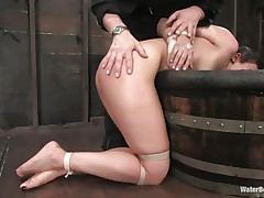 The old, experienced executor is showing this youthful hotty what this guy is capable of. He tied her hands and legs and grabbed her by the neck so this guy could put her head below water. That babe is wet and dominated and looks like this floozy enjoys her situation a lot, especially when this guy slaps her ass and uses a sex tool to stimulate her clit.