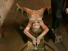 Golden-haired slut Cameron is all tied up with strings to a wooden table and face hole gagged. With her legs spread, that babe gets fingered and has a sex tool on her clitoris. Let`s take a close look at that hot oiled up body and with wax all over her! Will her goddess make that whore cum if her cunt gets fisted so hard?