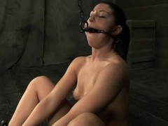 Girl receives her neck restrained and knockers clamped