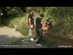 Tied chick fucked by 2 chaps in grass in public park