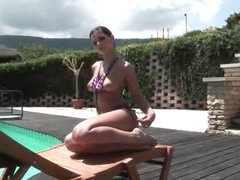 Hottie in a bikini poses poolside
